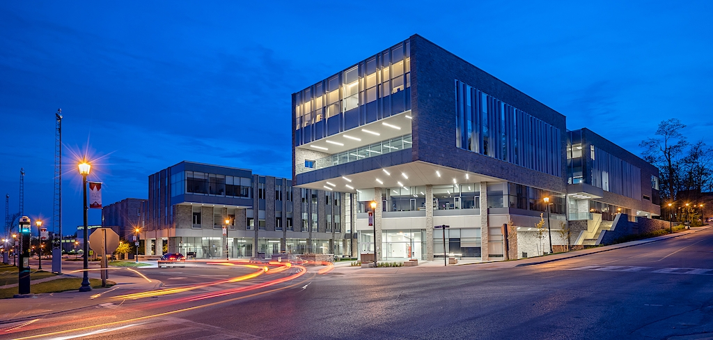 Architecture photographer scott webb shares photo of the fims & nursing building at twilight