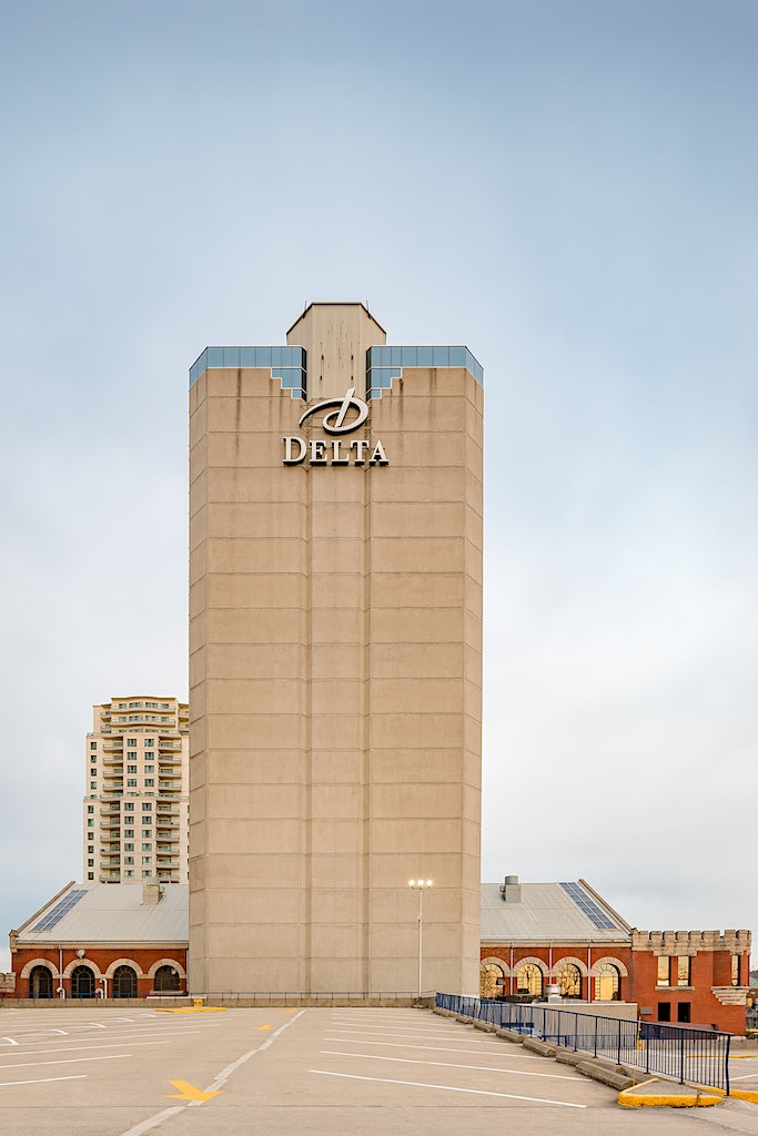 Delta Hotels by Marriott Armouries - View of Hotel from the Back during warm sunrise