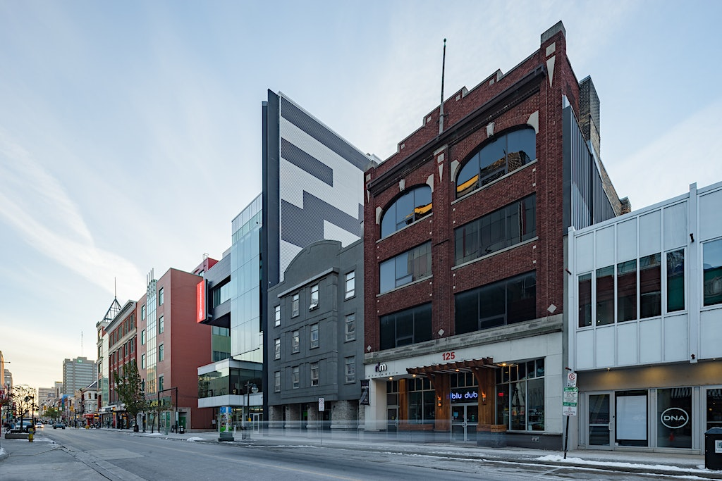 Exterior Architecture of Hotel Metro and showing additional context along Dundas Street