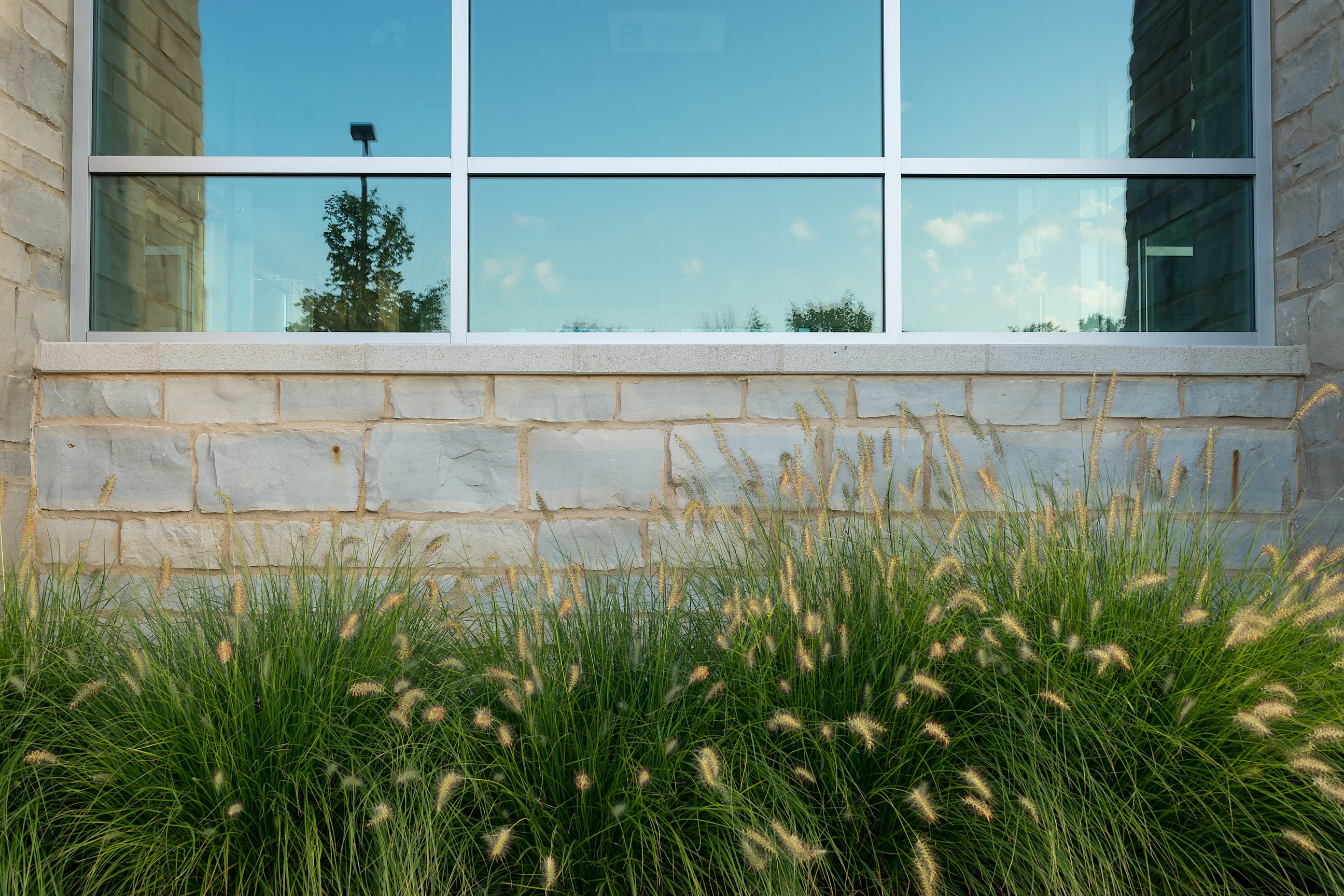 Close up to the front entrance of the church to show some landscaping too