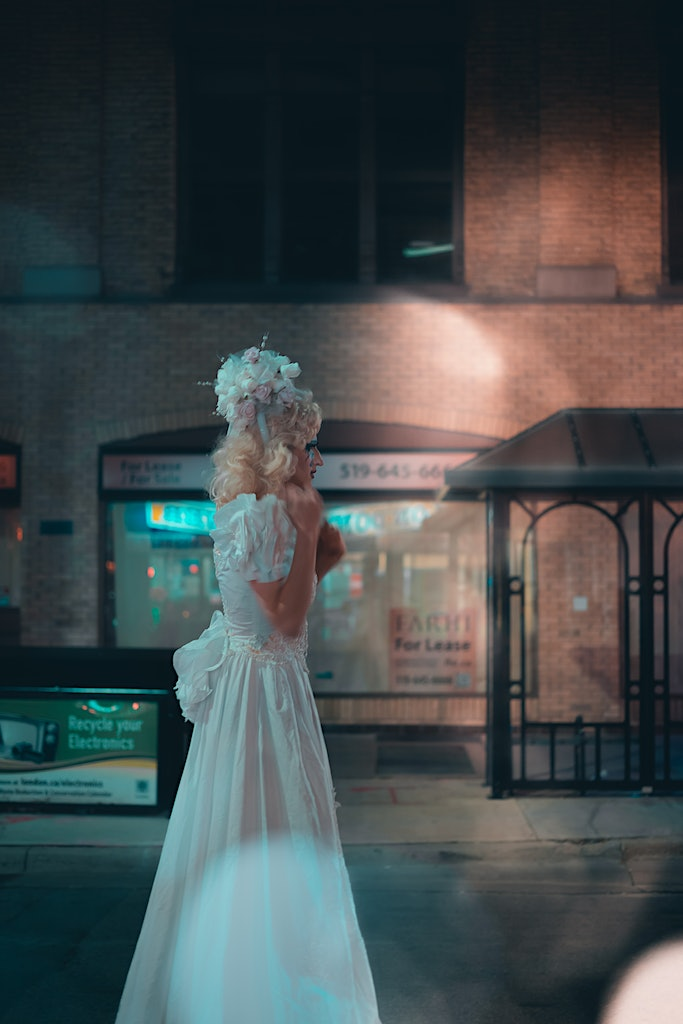 Tall bride broken-hearted at Nuit Blanche