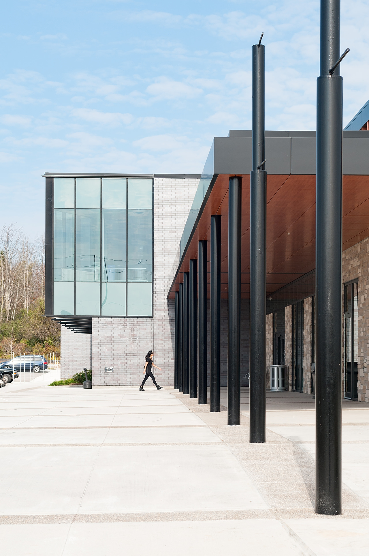 Person walking into the Stoney Creek YMCA - Architecture photo by Scott